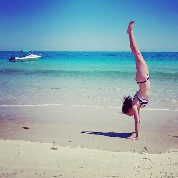 yoga beach hand stand